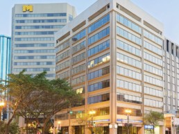 Downtown lights shine on 100 St Place, a great office location central to downtown Edmonton