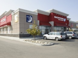 Shoppers Drug Mart building, located at Chestermere Station, a retail shopping centre.