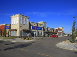 Bright blue sky and parking lot at the Kingsview Market, shopping retail centre and hub for Airdrie, Alberta.