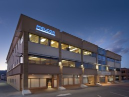 Kelowna location redeveloped by Melcor, this building glows with the dawn. Office property in Kelowna, called Richter Street.