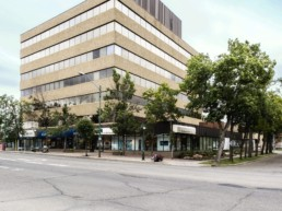 The Westcor Building sits on the corner in Edmonton - exterior outdoor view. Trees line the edges of the property, available as office space for lease.